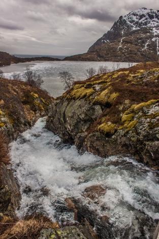 Waterfall to an Icy Lake - Lofoten, Norway