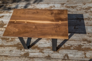 Black Walnut tables with Cherry inlay and raw steel legs